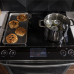 """GE Profile 30"""" Slide-In Electric Range with Induction Cooktops and Convection Oven, Model PHS930YPFS."""